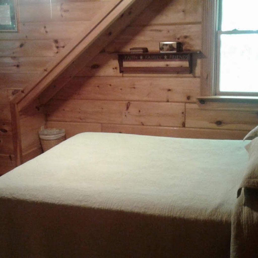 Queen bedroom with natural light